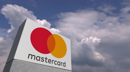 oficial : MASTERCARD logo against sky background, editorial animation Stock Footage