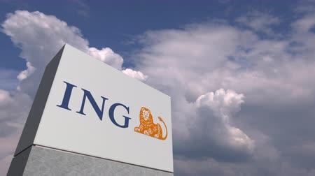ing : Logo of ING on a stand against cloudy sky, editorial animation