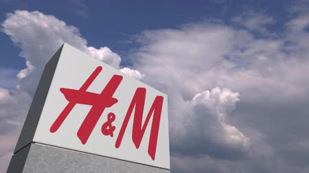 sziám : H&M logo on sky background, editorial animation