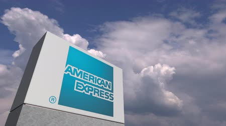 выражать : AMERICAN EXPRESSlogo on sky background, editorial animation Стоковые видеозаписи