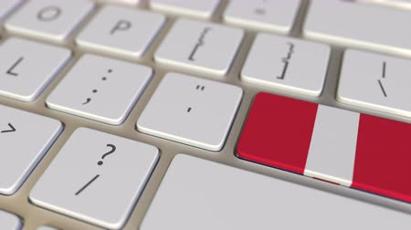 relocate : Key with flag of Peru on the computer keyboard switches to key with flag of Great Britain, translation or relocation related animation