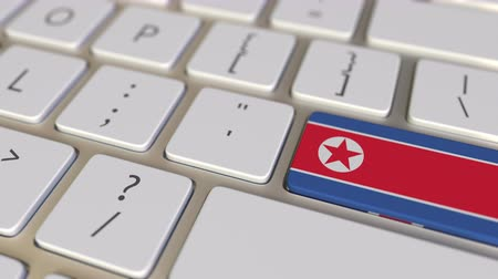 dprk : Key with flag of North Korea on the computer keyboard switches to key with flag of Great Britain, translation or relocation related animation Stock Footage