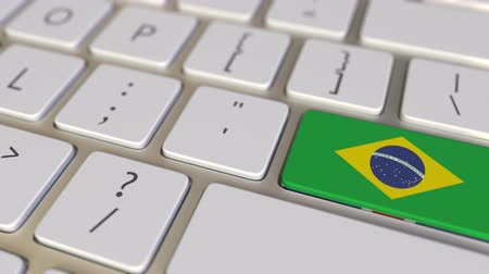 brazil : Key with flag of Brazil on the computer keyboard switches to key with flag of Great Britain, translation or relocation related animation