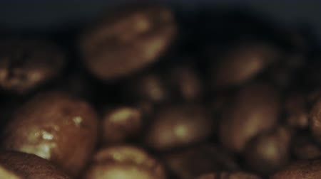 kahve çekirdeği : Roasted coffee beans fall near camera, extreme close-up dolly shot Stok Video