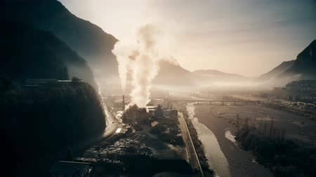 hazardous : Aerial shot of air polluting plant in the river valley