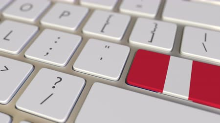 perui : Key with flag of Peru on the computer keyboard switches to key with flag of France, translation or relocation related animation