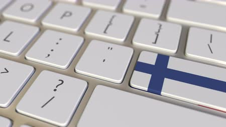 fince : Key with flag of Finland on the computer keyboard switches to key with flag of France, translation or relocation related animation