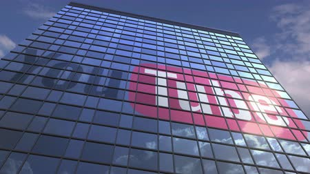 oficial : Logo of YOUTUBE on a media facade with reflecting cloudy sky, editorial animation Stock Footage