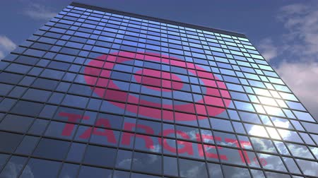 refletir : TARGET logo against modern building reflecting sky and clouds, editorial animation