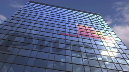 pwc : Logo of PWC on a media facade with reflecting cloudy sky, editorial animation