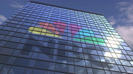 odrážející : Logo of NBC on a media facade with reflecting cloudy sky, editorial animation