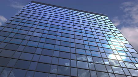 反射する : Logo of IBM on a media facade with reflecting cloudy sky, editorial animation 動画素材