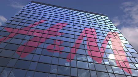 sziám : H&M logo on modern building reflecting sky and clouds, editorial animation Stock mozgókép