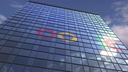 zrcadlící : Logo of GOOGLE on a media facade with reflecting cloudy sky, editorial animation