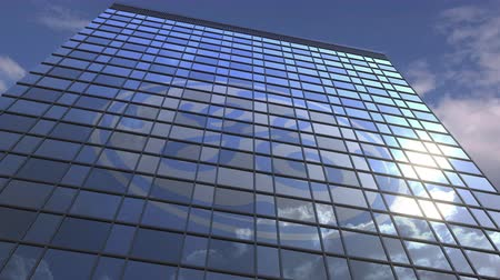general electric : Logo of GENERAL ELECTRIC on a media facade with reflecting cloudy sky, editorial animation Stock Footage