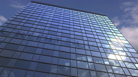 credit suisse : CREDIT SUISSE logo against modern building reflecting sky and clouds, editorial animation Stock Footage