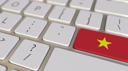 вьетнамский : Key with flag of Vietnam on the computer keyboard switches to key with flag of China, translation or relocation related animation