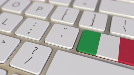 relocate : Key with flag of Italy on the computer keyboard switches to key with flag of China, translation or relocation related animation