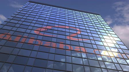 oficial : ALIBABA GROUP logo against modern building reflecting sky and clouds, editorial animation