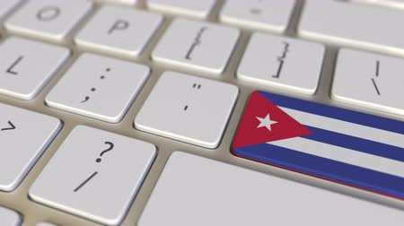 relocate : Key with flag of Cuba on the computer keyboard switches to key with flag of China, translation or relocation related animation