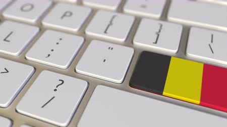 бельгийский : Key with flag of Belgium on the computer keyboard switches to key with flag of China, translation or relocation related animation