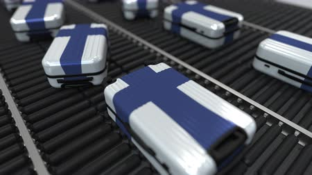 handling : Many travel suitcases featuring flag of Finland. Finnish tourism conceptual animation