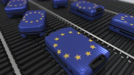 ağır çekimli : Many travel suitcases featuring flag of the European Union. EU tourism conceptual animation