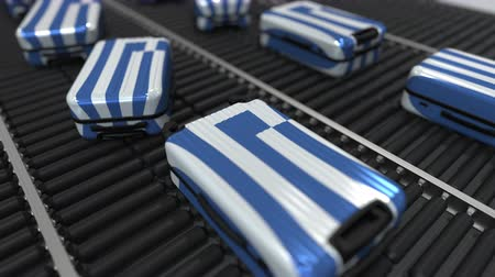handling : Many travel suitcases featuring flag of Greece. Greek tourism conceptual animation