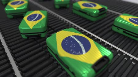handling : Many travel suitcases featuring flag of Brazil Stock Footage