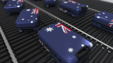 australiano : Many travel suitcases featuring flag of Australia. Australian tourism conceptual animation