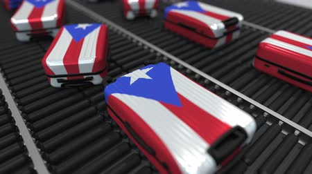 handling : Many travel suitcases featuring flag of Puerto Rico on roller conveyer. Puerto Rican tourism conceptual animation Stock Footage