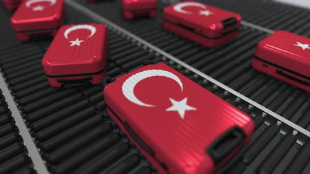 handling : Many travel suitcases featuring flag of Turkey on roller conveyer. Turkish tourism conceptual animation Stock Footage