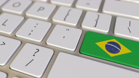 brasileiro : Key with flag of Brazil on the keyboard switches to key with flag of Germany, translation or relocation related animation