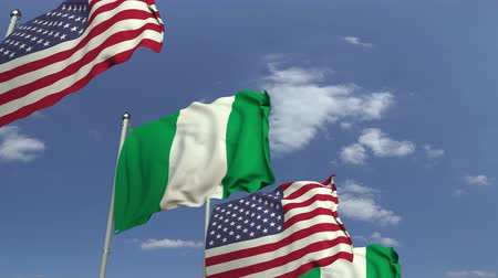 nigeria : Flags of Nigeria and the USA against blue sky, loopable 3D animation Stock Footage