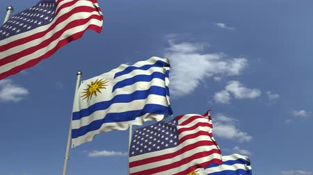 Уругвай : Flags of Uruguay and the USA against blue sky, loopable 3D animation