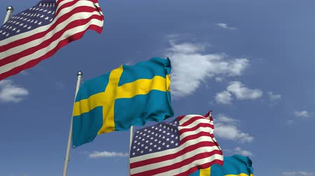 şaft : Many flags of Sweden and the USA, loopable 3D animation Stok Video