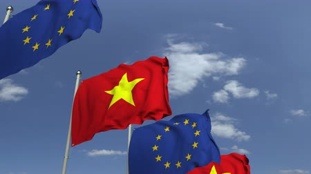 vietnami : Flags of Vietnam and the European Union at international meeting, loopable 3D animation Stock mozgókép
