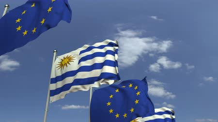 Уругвай : Flags of Uruguay and the European Union against blue sky, loopable 3D animation