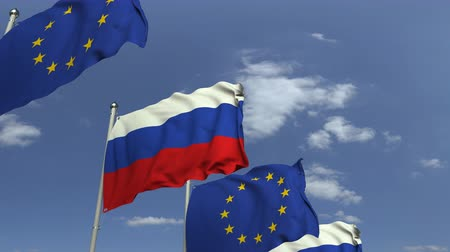 mastro de bandeira : Flags of Russia and the European Union against blue sky, loopable 3D animation