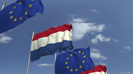 foreign national : Flags of Netherlands and the European Union against blue sky, loopable 3D animation Stock Footage