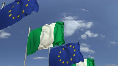 nigeria flag : Flags of Nigeria and the European Union against blue sky, loopable 3D animation Stock Footage