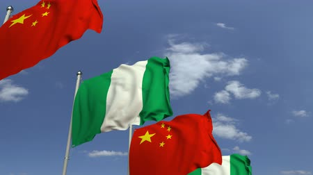 nigeria flag : Flags of Nigeria and China against blue sky, loopable 3D animation