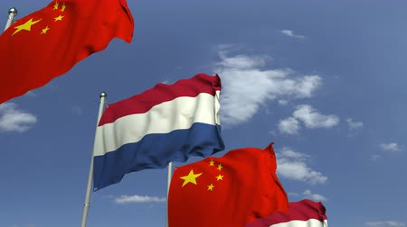 foreign national : Flags of Netherlands and China against blue sky, loopable 3D animation Stock Footage
