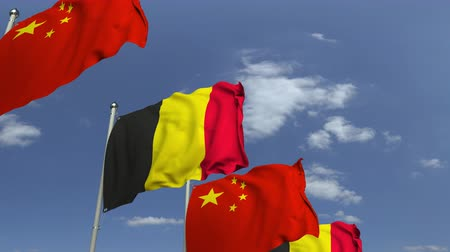 belga : Flags of Belgium and China against blue sky, loopable 3D animation