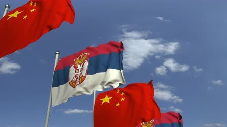 sérvia : Waving flags of Serbia and China on sky background, loopable 3D animation