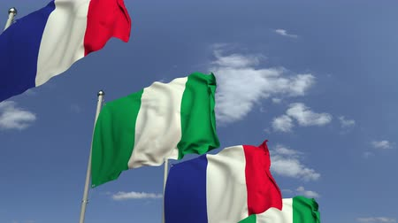 nigeria flag : Flags of Nigeria and France against blue sky, loopable 3D animation