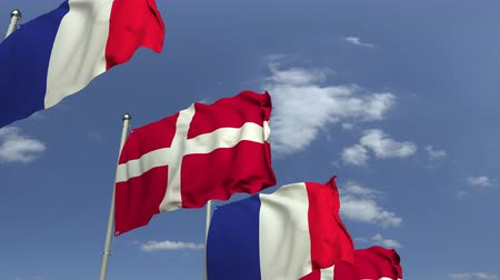 şaft : Waving flags of Denmark and France on sky background, loopable 3D animation Stok Video