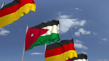 meeting negotiate : Waving flags of Jordan and Germany on sky background, loopable 3D animation