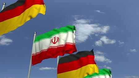 foreign national : Waving flags of Iran and Germany on sky background, loopable 3D animation