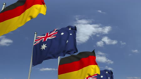 вал : Flags of Australia and Germany at international meeting, loopable 3D animation